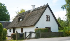 Love the thatch and dormer window.