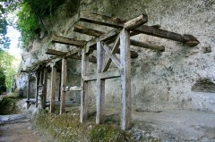 Shows how the frames were built using holes chiseled in rock
