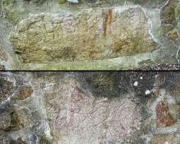 Mystery fragments in Klemensker Churchyard wall.