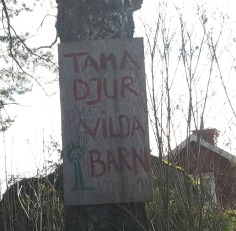 A sign for 'Tame Animals, Wild Children' in the area